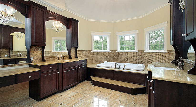 Master bath in new construction home with dark wood cabinetry